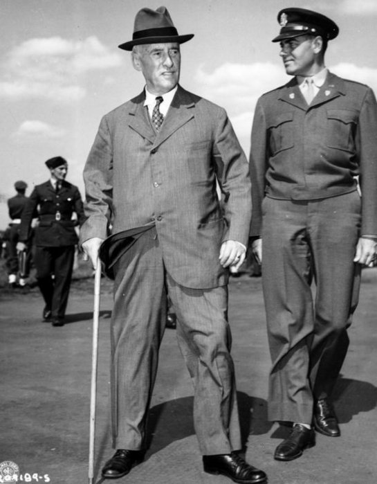 Secretary of War Henry L. Stimson (with military aid Col. W. H. Kyle)