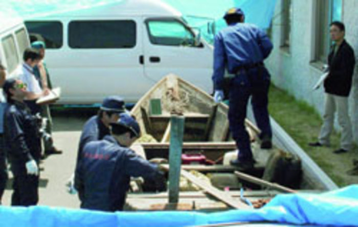 Fukaura police examine boat that contained North Korean refugees
