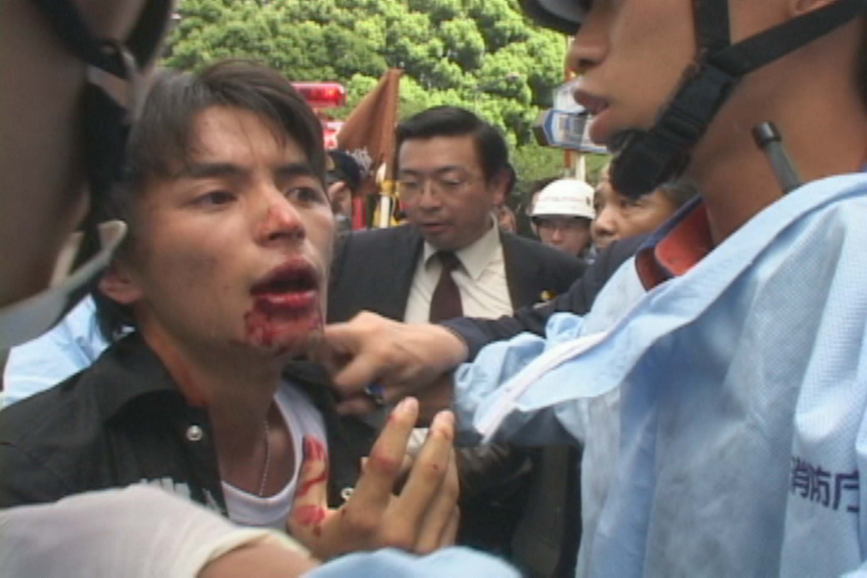 Protester beaten and taken by the police.